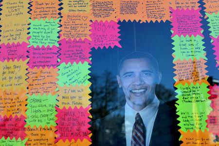Messages are seen next to a cut-out of former U.S. President Barack Obama at a local shop during President Day holiday in Washington U.S., February 20, 2017. REUTERS/Carlos Barria