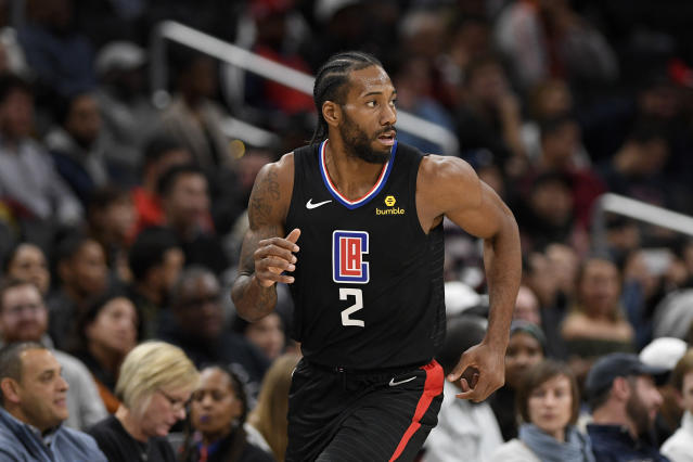 Los Angeles Clippers forward Kawhi Leonard (2) runs on the court during the second half of an NBA basketball game against the Washington Wizards, Sunday, Dec. 8, 2019, in Washington. The Clippers won 135-119. (AP Photo/Nick Wass)
