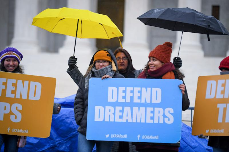 People stand in the cold and rain outside the U.S. Supreme Court on Nov. 12 before arguments on whether the Trump administration's decision to end the Deferred Action for Childhood Arrivals program (DACA) is lawful.