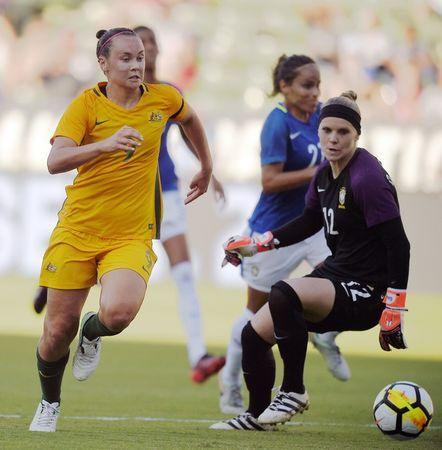 Aug 3, 2017; Carson, CA, USA; Australia midfielder Caitlin Foord (9) moves the ball past Brazil goalkeeper Dani Neuhaus (12) to score a goal during the second half at StubHub Center. Australia won 6-1. Mandatory Credit: Kelvin Kuo-USA TODAY Sports