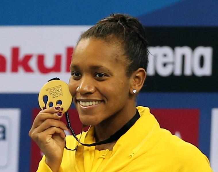 Alia Atkinson of Jamaica poses with her gold medal after winning in the women's 100m Breaststroke during the 12th FINA World Swimming Championships (25m) in Doha on December 6, 2014