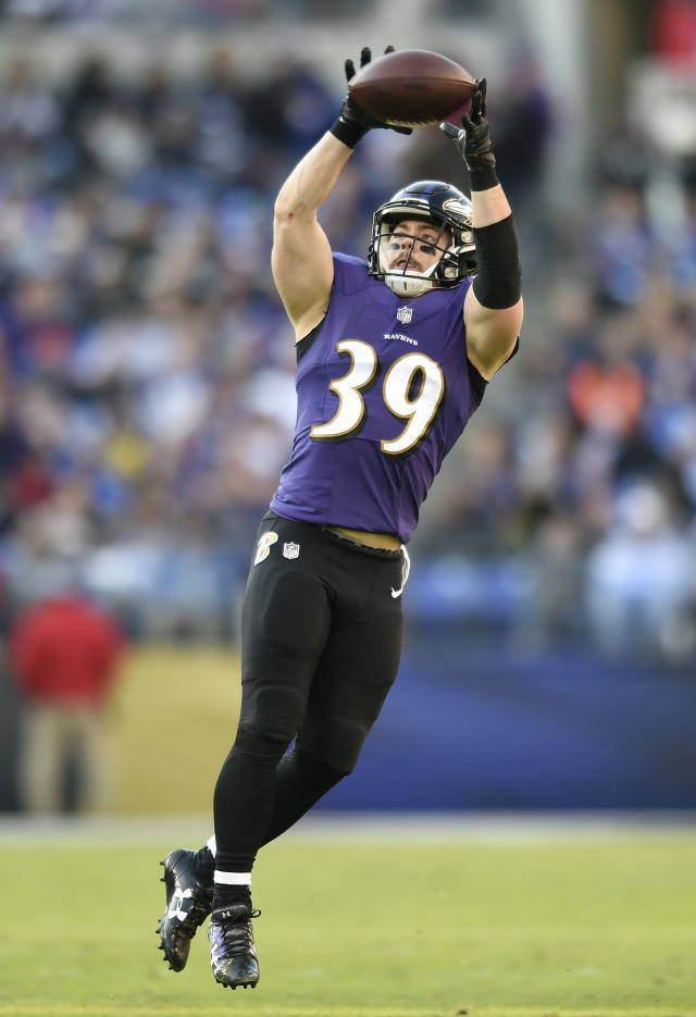 File-This Dec. 3, 2017, file photo shows Baltimore Ravens running back Danny Woodhead making a catch in the second half of an NFL football game against the Detroit Lions, in Baltimore. Woodhead has announced his retirement from the NFL after 10 seasons. Woodhead, who played with Baltimore last season, wrote in an Instagram post early Saturday, march 17, 2018, that it is time for him to leave the game he loves. The 5-foot-8 Woodhead was a two-time Harlon Hill Trophy winner at Chadron State in Nebraska as the top player in NCAA Division II. Despite his college success, he went undrafted in 2008 and signed with the New York Jets as a free agent. (AP Photo/Gail Burton, File)