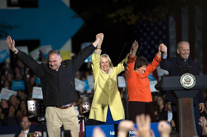 <p>Democratic vice presidential candidate Sen. Tim Kaine, D-Va., Jill Biden, his wife Anne Holton and Vice President Joe Biden celebrate on stage after a campaign rally at George Mason University on Monday, Nov. 7, 2016 in Fairfax, Va. (Photo: Molly Riley/AP) </p>