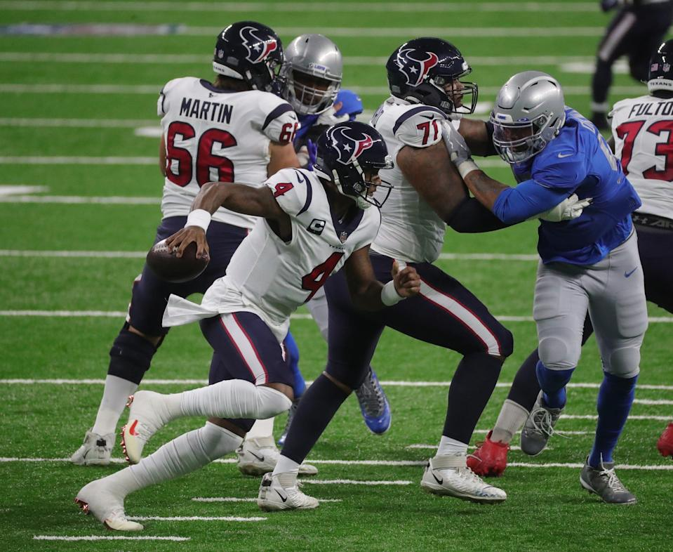 Lions defensive end Romeo Okwara, right, rushes Texans quarterback Deshaun Watson during the first half at Ford Field on Thursday, Nov  26, 2020.