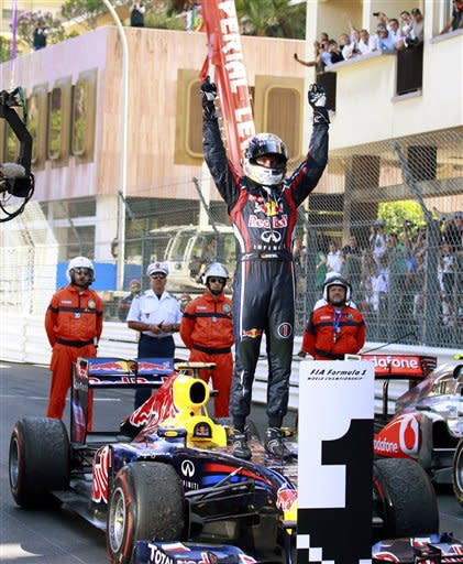 Red Bull driver Sebastian Vettel of Germany celebrates after winning the Monaco Formula One Grand Prix, at the Monaco racetrack, in Monaco, Sunday, May 29, 2011. (AP Photo/Luca Bruno)
