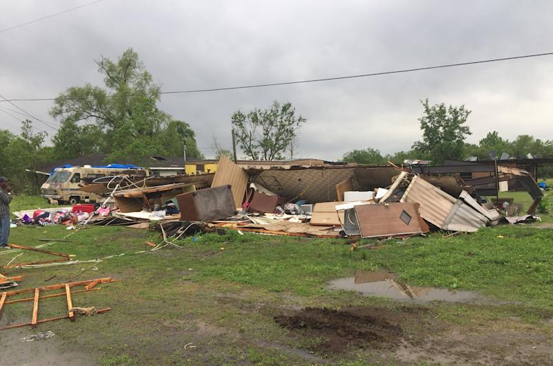 In this photo provided by the St. Martin Parish Sheriff's Office, the remains of a trailer lie where a woman and her 3-year-old daughter were killed during a severe storm, in Breaux Bridge, La., Sunday, April 2, 2017. A tornado flipped the mobile home Sunday in Louisiana, killing the mother and her daughter as a storm system with hurricane-force winds crawled across the Deep South, damaging homes and businesses. (Maj. Ginny Higgins/St. Martin Parish Sheriff's Office via AP)