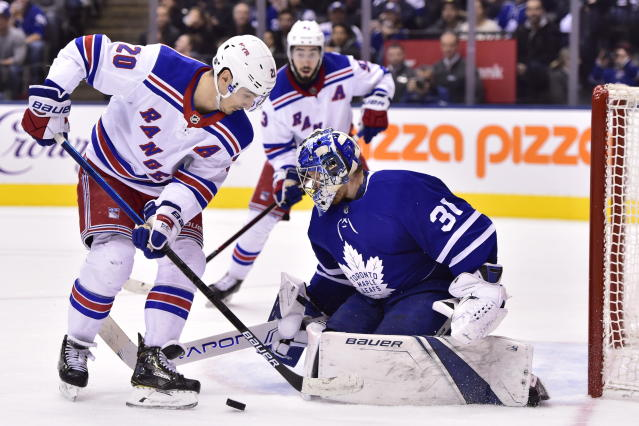 Toronto Maple Leafs goaltender Frederik Andersen (31) stops New York Rangers left wing Chris Kreider (20) during the third period of an NHL hockey game Saturday, Dec. 22, 2018, in Toronto. (Frank Gunn/The Canadian Press via AP)
