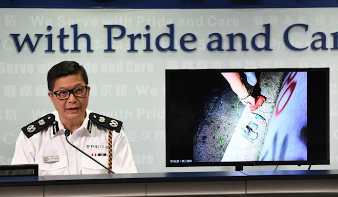 Tang Ping-keung, deputy commissioner of police, shows an image of the home-made bomb thought to be used by a protester on Sunday. Photo: Xinhua