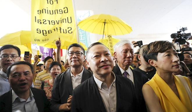 Tanya Chan (right) with Occupy leader Benny Tai (centre) and others outside the West Kowloon Law Courts Building in Cheung Sha Wan. Photo: Sam Tsang