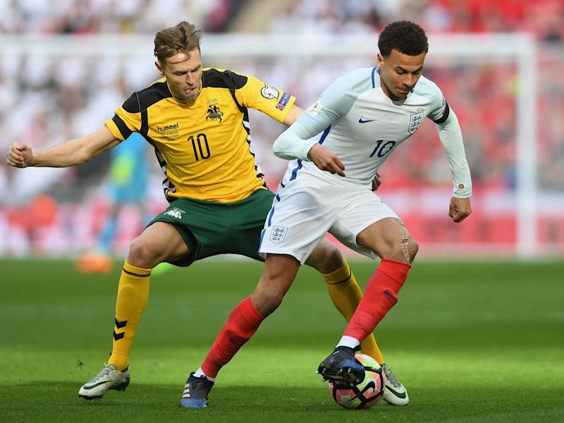 Dele Alli dribbles with the ball in the opening stages at Wembley (Getty)