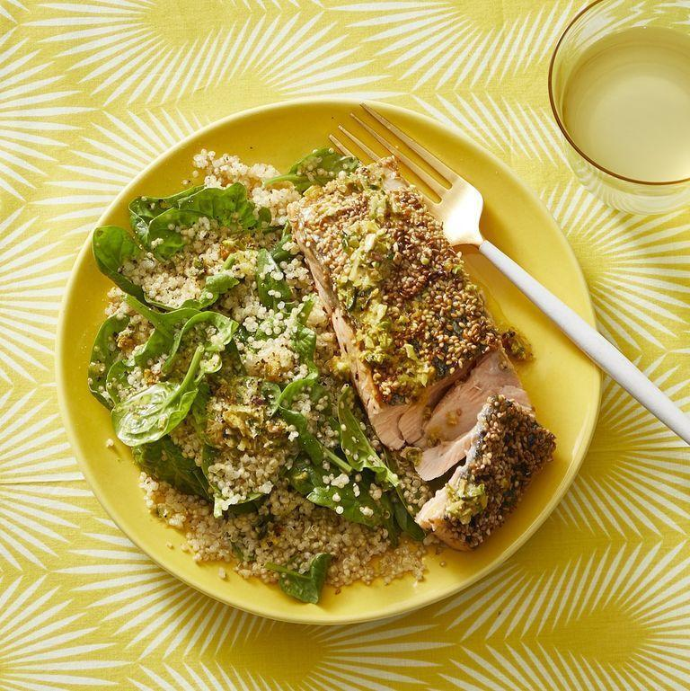 """<p>Step up your salmon game with this recipe. Cover the fish in sesame seeds before cooking it on the stove. Then serve it with a side of quinoa and spinach salad. <br></p><p><em><a href=""""https://www.womansday.com/food-recipes/food-drinks/a30394191/sesame-salmon-with-quinoa-pilaf-and-pistachio-vinaigrette-recipe/"""" rel=""""nofollow noopener"""" target=""""_blank"""" data-ylk=""""slk:Get the Sesame Salmon with Quinoa Pilaf and Pistachio Vinaigrette"""" class=""""link rapid-noclick-resp"""">Get the Sesame Salmon with Quinoa Pilaf and Pistachio Vinaigrette </a></em><em><a href=""""https://www.womansday.com/food-recipes/food-drinks/a30394191/sesame-salmon-with-quinoa-pilaf-and-pistachio-vinaigrette-recipe/"""" rel=""""nofollow noopener"""" target=""""_blank"""" data-ylk=""""slk:recipe."""" class=""""link rapid-noclick-resp"""">recipe.</a></em></p>"""