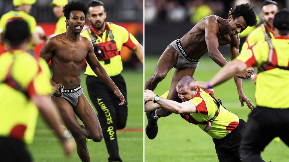 The pitch invader, pictured here being taken down by security guards at Optus Stadium.