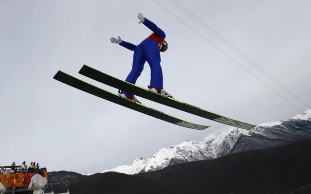 Japan's Akito Watabe soars through the air during a men's nordic combined training session at the 2014 Winter Olympics, Sunday, Feb. 9, 2014, in Krasnaya Polyana, Russia. (AP Photo/Dmitry Lovetsky)