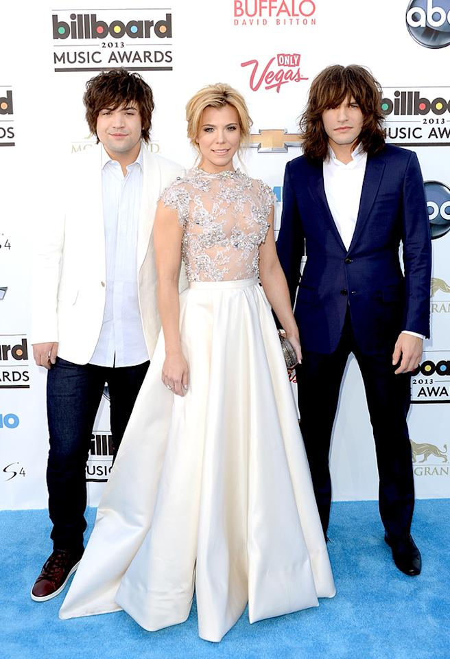 LAS VEGAS, NV - MAY 19:  (L-R) Singers Neil Perry, Kimberly Perry, and Reid Perry of The Band Perry arrive at the 2013 Billboard Music Awards at the MGM Grand Garden Arena on May 19, 2013 in Las Vegas, Nevada.  (Photo by Jason Merritt/Getty Images)