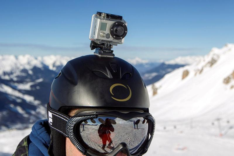 FILE PHOTO: A skier wears a GoPro camera on his helmet as he rides down the slopes in the ski resort of Meribel