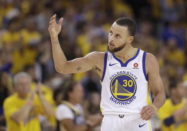 Stephen Curry and the Warriors put the clamps down on the Rockets in the second half for a stunning turnaround win. (AP)