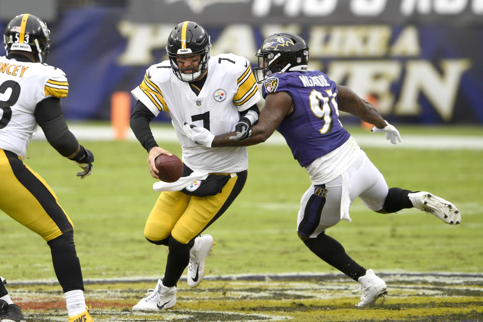 Baltimore Ravens defensive end Yannick Ngakoue (91) applies pressure on Pittsburgh Steelers quarterback Ben Roethlisberger (7) during the first half of an NFL football game, Sunday, Nov. 1, 2020, in Baltimore. (AP Photo/Nick Wass)