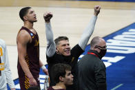 Loyola Chicago head coach Porter Moser celebrates beating Illinois 71-58 after a men's college basketball game in the second round of the NCAA tournament at Bankers Life Fieldhouse in Indianapolis, Sunday, March 21, 2021. (AP Photo/Paul Sancya)
