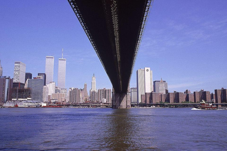 <p>The Brooklyn Bridge extends to Manhattan with the World Trade Center in the background.</p>