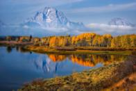 """<p>Located in Grand Teton National Park, Oxbow Bend boasts a picture-perfect view of Mt. Moran, complete with golden Aspen trees reflecting in the Snake River. </p><p><a class=""""link rapid-noclick-resp"""" href=""""https://go.redirectingat.com?id=74968X1596630&url=https%3A%2F%2Fwww.tripadvisor.com%2FHotels-g60524-Moran_Jackson_Hole_Wyoming-Hotels.html&sref=https%3A%2F%2Fwww.thepioneerwoman.com%2Fhome-lifestyle%2Fg36804013%2Fbest-places-to-see-fall-foliage%2F"""" rel=""""nofollow noopener"""" target=""""_blank"""" data-ylk=""""slk:FIND A HOTEL"""">FIND A HOTEL</a></p>"""