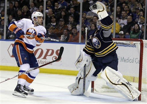 Buffalo Sabres goalie Ryan Miller makes a save under pressure from New York Islanders' John Tavares (91) during the second period of an NHL hockey game in Buffalo, N.Y., Tuesday, Feb. 21, 2012. (AP Photo/David Duprey)