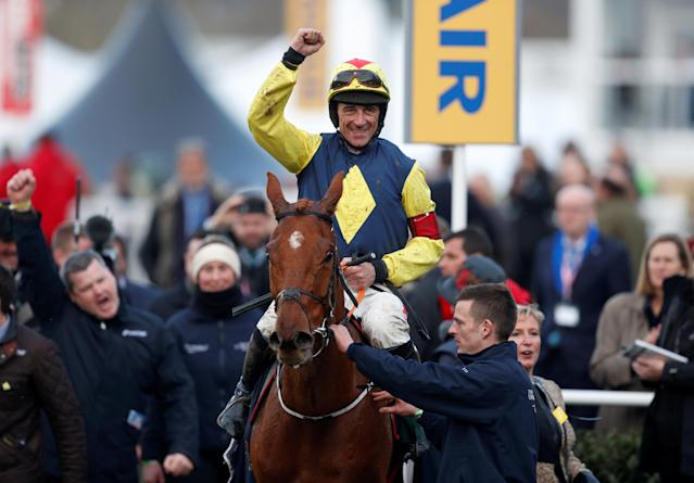 Horse Racing - Cheltenham Festival - Cheltenham Racecourse, Cheltenham, Britain - March 15, 2018 Davy Russell celebrates on The Storyteller after winning the 16:10 Brown Advisory & Merriebelle Stable Plate Handicap Chase Action Images via Reuters/Matthew Childs