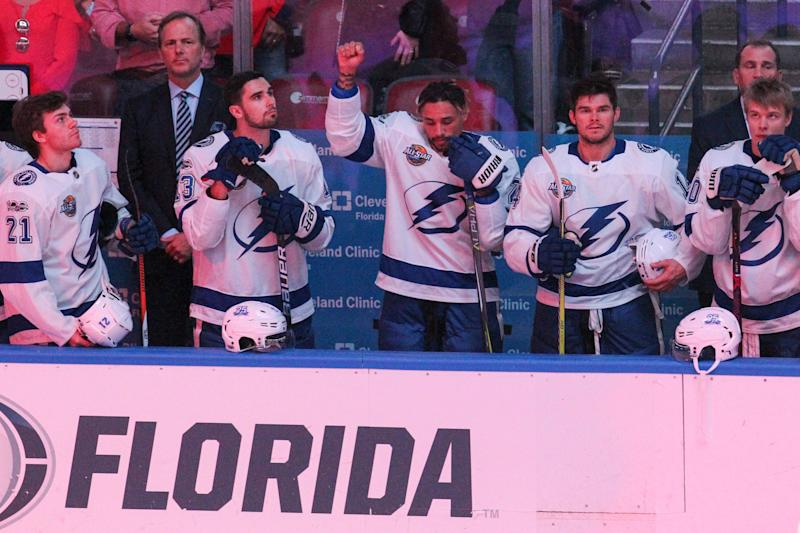 The Tampa Bay Lightning's J.T. Brown protests during the national anthem before the start of a game against the Florida Panthers at the BB&T Center in Sunrise, Fla., on Saturday, Oct. 7, 2017.