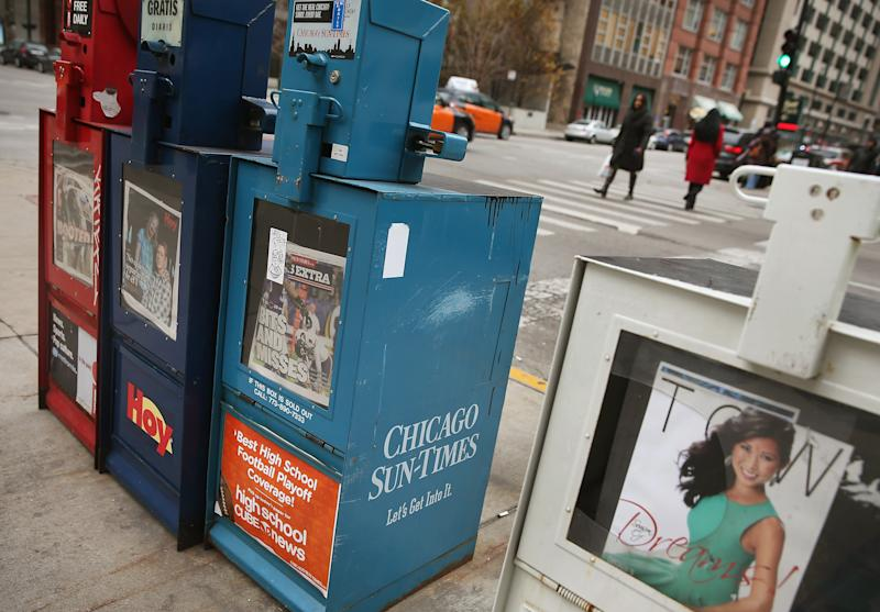 A vending machine sells Chicago Sun-Times newspapers on a street corner in the Loop on December 2, 2013 in Chicago, Illinois