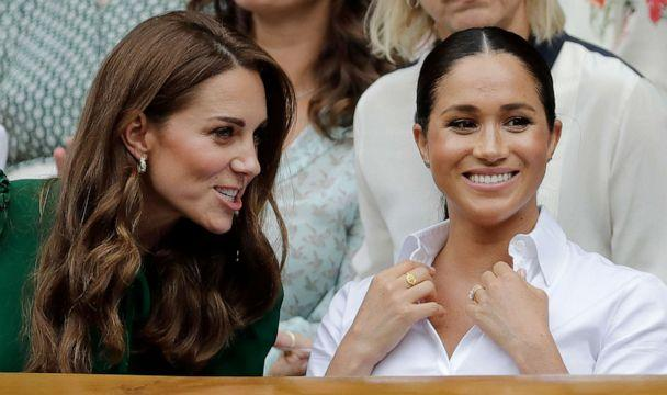 PHOTO: Kate, Duchess of Cambridge, left, and Meghan, Duchess of Sussex chat as they sit in the Royal Box on Centre Court to watch the women's singles final match between Serena Williams of the U.S. and Romania's Simona Halep in London, July 13, 2019. (Ben Curtis/AP)