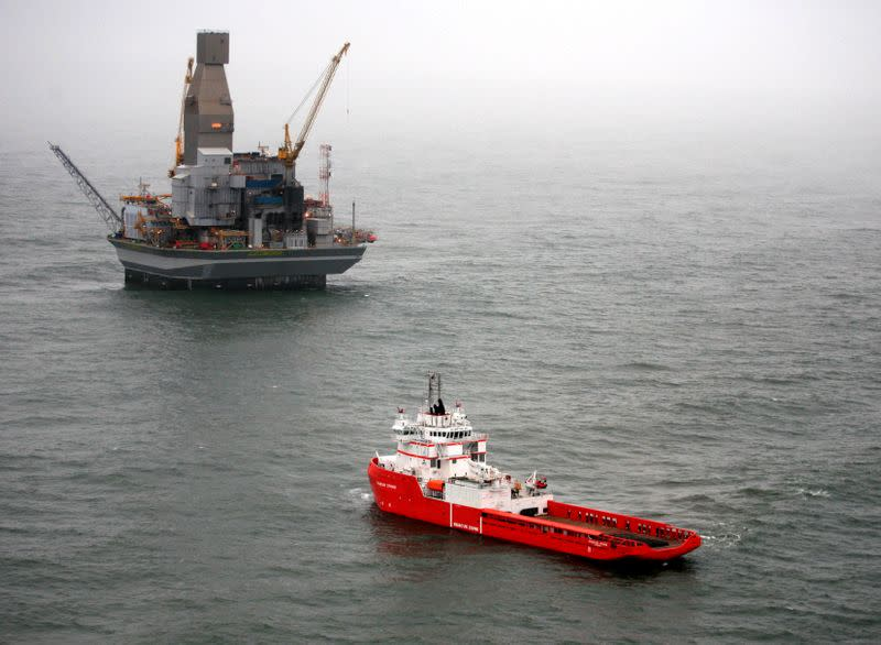 FILE PHOTO: A vessel leaves the Orlan oil plattform at Sakhalin-1's off-shore rig at the Chaivo field, some 11 km (7 miles) off the east cost of Sakhalin island