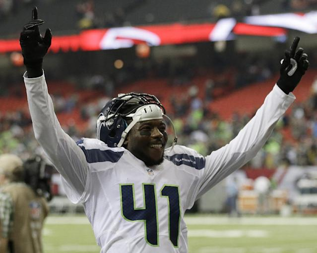 Seattle Seahawks cornerback Byron Maxwell (41) celebrates a Seattle Seahawks victory over the Atlanta Falcons 33-10 after the second half of an NFL football game, Sunday, Nov. 10, 2013, in Atlanta. (AP Photo/John Bazemore)