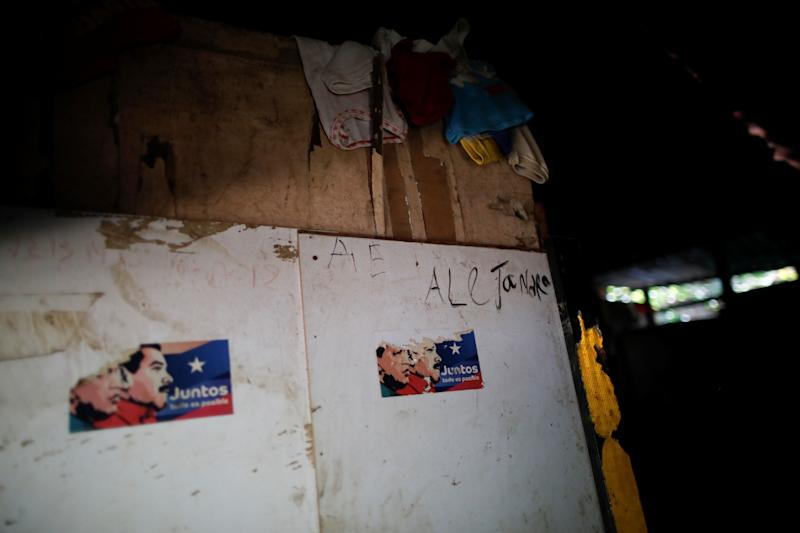 Stickers showing former Venezuelan President Hugo Chavez and President Nicolas Maduro