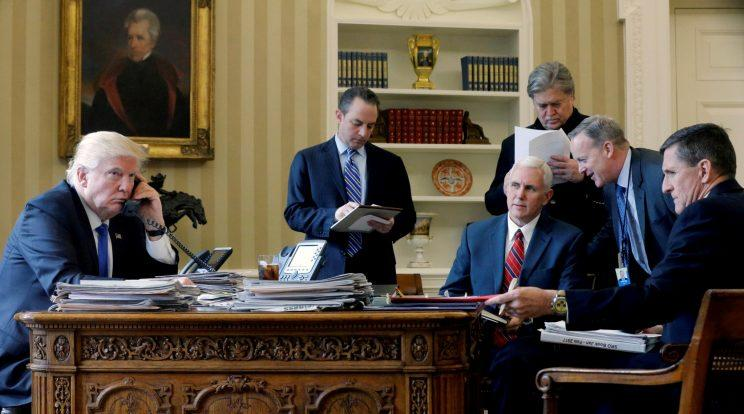 Trump, joined by Reince Priebus, Vice President Mike Pence, Steve Bannon, Sean Spicer and then-National Security Advisor Michael Flynn, speaks by phone with Russian President Vladimir Putin in the Oval Office, Jan. 28, 2017. (Jonathan Ernst/Reuters)