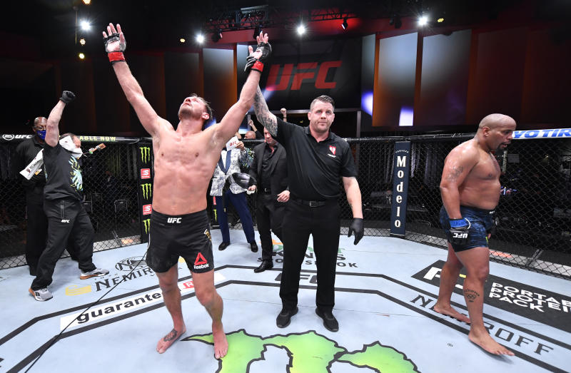 LAS VEGAS, NEVADA - AUGUST 15: Stipe Miocic celebrates after his victory over Daniel Cormier in their UFC heavyweight championship bout during the UFC 252 event at UFC APEX on August 15, 2020 in Las Vegas, Nevada. (Photo by Jeff Bottari/Zuffa LLC)