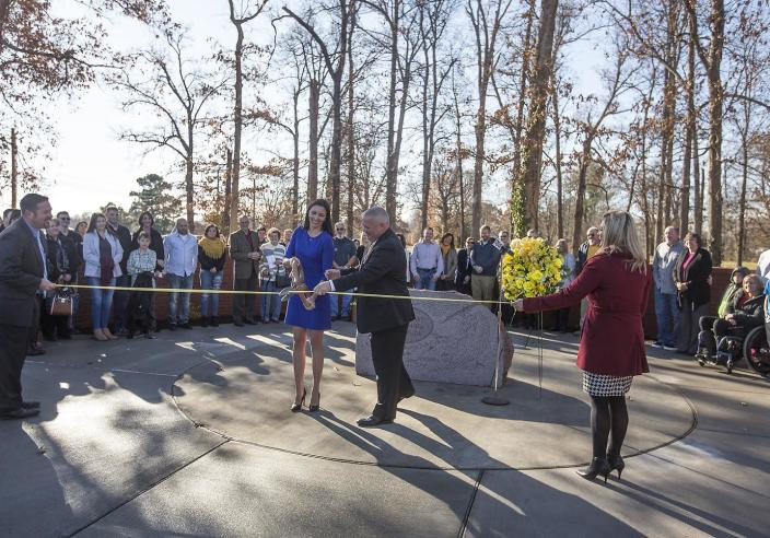 Survivors, family and community members attend a ribbon cutting ceremony Dec. 1, 2017, at the new location of a memorial for the victims of the Heath High School shooting. (Photo: Ryan Hermens/The Paducah Sun)