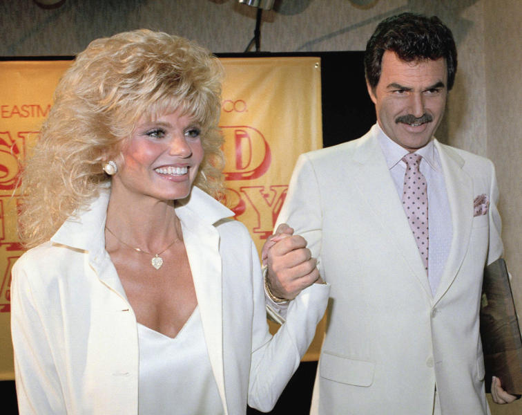 Reynolds holds hands with his wife Loni Anderson in Los Angeles (Bob Galbraith/PA)