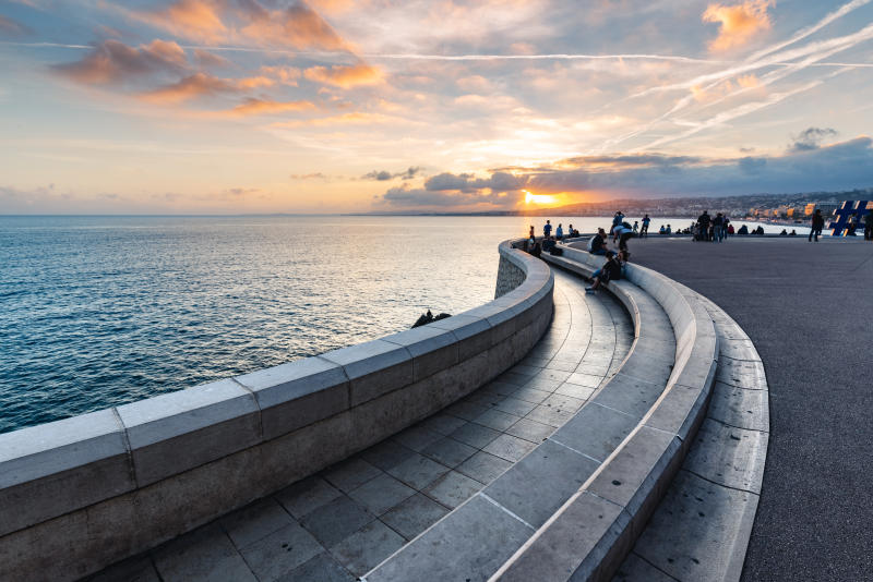 People enjoying sunset on the waterfront in Nice, Alpes-Maritimes, France