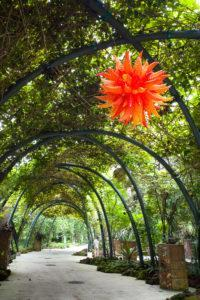 Chihuly Studio's 'Orange Hornet Chandelier' at the World of Plants. Photo: Coconuts