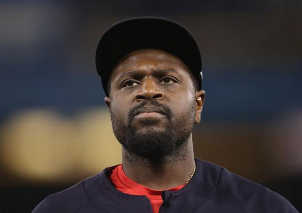 Brandon Phillips doesn't think the Reds should have given his No. 4 to Scooter Gennett. (Getty Images)