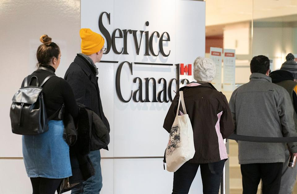 People line up at a Service Canada office in Montreal on Thursday, March 19, 2020.  (Photo: Paul Chiasson/The Canadian Press)