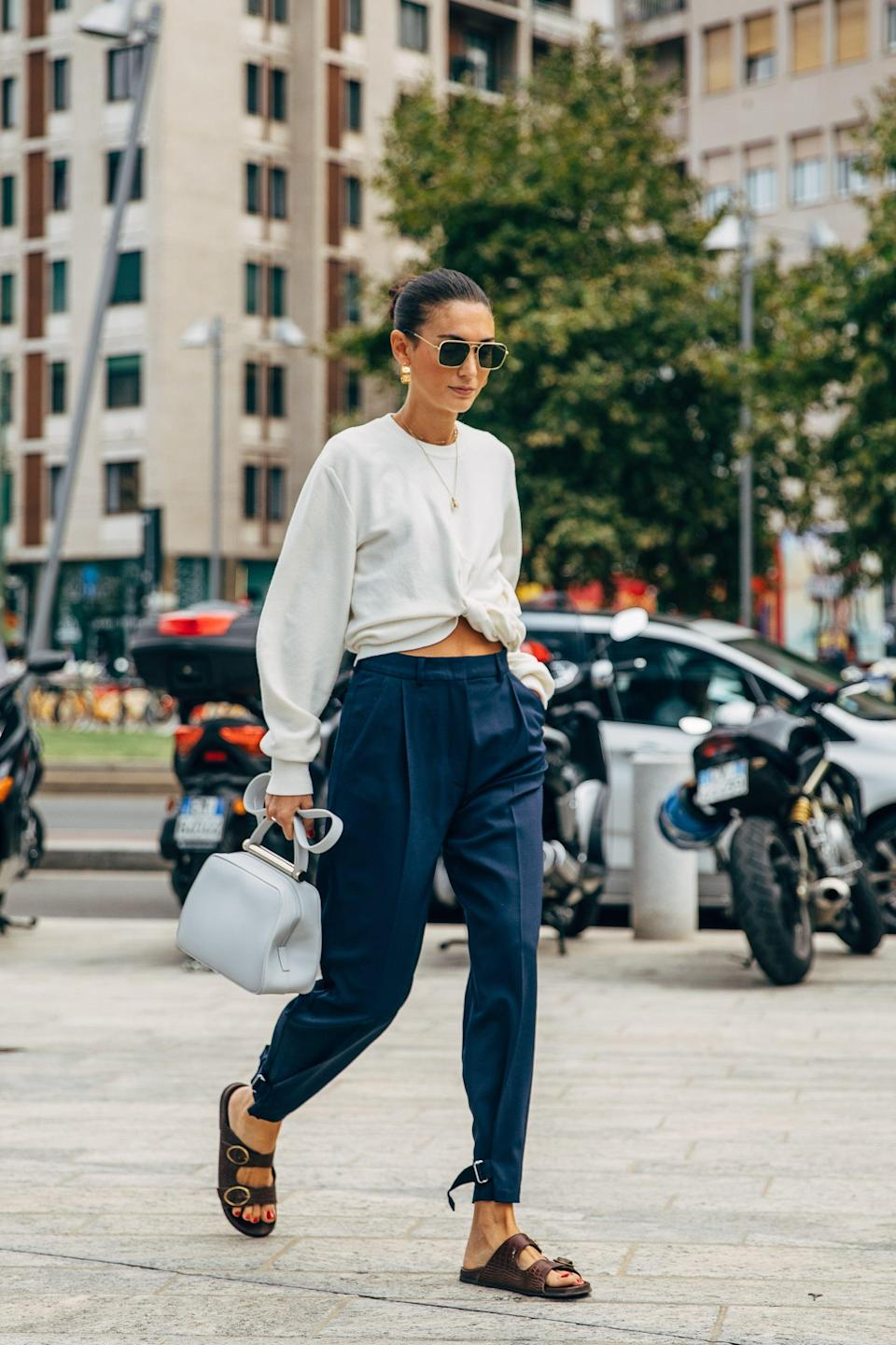 <p>Remix tailored trousers when you show a little midriff and add Birkenstocks. </p>