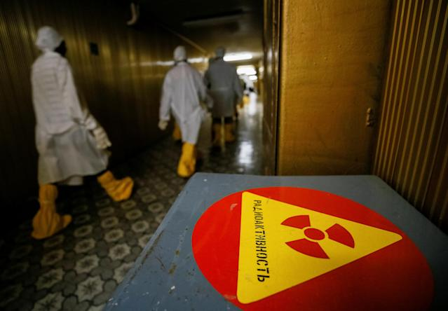 <p>Journalists walk through the corridor of the stopped third reactor at the Chernobyl nuclear power plant in Chernobyl, Ukraine, April 20, 2018. (Photo: Gleb Garanich/Reuters) </p>