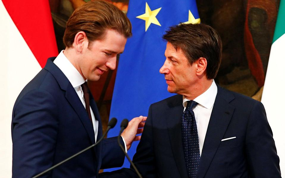 Sebastian Kurz and Italian Prime Minister Giuseppe Conte talk at the end of a news conference in Rome - REUTERS