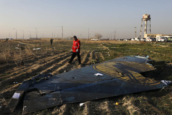 A rescue worker searches the scene where a Ukrainian plane crashed in Shahedshahr southwest of the capital Tehran, Iran, Wednesday, Jan. 8, 2020. (Photo: Ebrahim Noroozi/AP)
