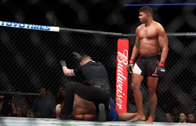 Alistair Overeem (R) stands by after knocking out Mark Hunt in the third round of a heavyweight bout at UFC 209. (Getty)