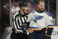 Linesman Bryan Pancich, left, pushes away St. Louis Blues left wing Kyle Clifford after he tangled with Colorado Avalanche goaltender Philipp Grubauer as time ran out in Game 1 of an NHL hockey Stanley Cup first-round playoff series Monday, May 17, 2021, in Denver. Colorado won 4-1. (AP Photo/David Zalubowski)