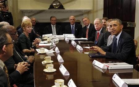 U.S. President Barack Obama meets with health insurance chief executives at the White House in Washington November 15, 2013. REUTERS/Kevin Lamarque