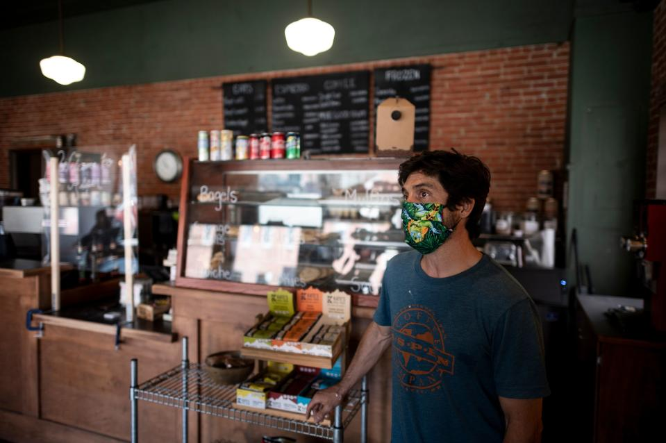 """Kelly Lyda, owner of the Aspen Cafe, stands in his Cafe on May 5, 2020 in Stillwater, Oklahoma. - In the face of intimidation against employees and the threat of an armed attack by local residents wielding their individual liberties, the mayor of Stillwater had to give in: he gave up imposing the wearing of masks on customers in shops. This demand was included in a 21-page document that was supposed to accompany the gradual reopening of restaurants and shops from 1 May, as authorized by the state of Oklahoma. """"About three and a half hours after the law came into effect"""" of the text, """"we started receiving calls from stores claiming that employees were being threatened and insulted, and threatened with physical violence,"""" said Norman McNickle, the city's director of services. (Photo by Johannes EISELE / AFP) (Photo by JOHANNES EISELE/AFP via Getty Images)"""