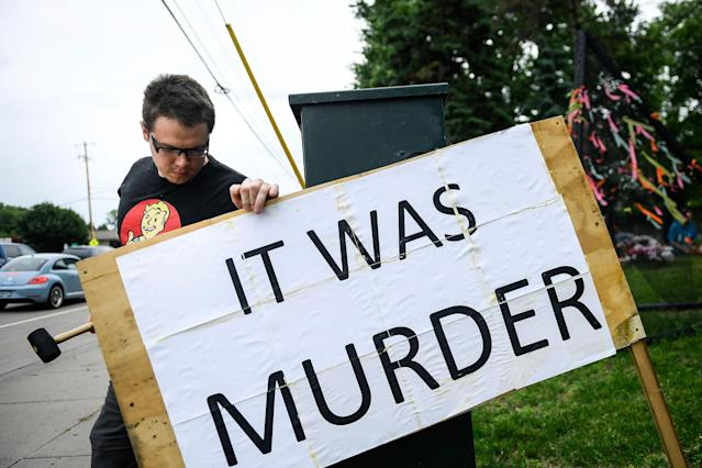 <p>Bob Edwards, of St. Anthony, uses a mallet Friday, June 16, 2017, in Falcon Heights, Minn., to install a sign he made near the site where Philando Castile was shot and killed during a traffic stop by St. Anthony police Officer Jeronimo Yanez last year. Yanez was cleared Friday in the fatal shooting of Castile, a black motorist whose death captured national attention when his girlfriend streamed the grim aftermath on Facebook. (Aaron Lavinsky/Star Tribune via AP) </p>
