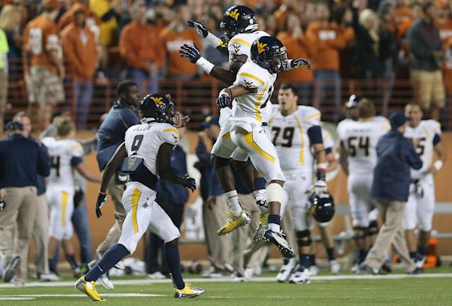 AUSTIN, TX - OCTOBER 06: (L-R) KJ Myers #19 and Dustin Brown #23 of the West Virginia Mountaineers celebrate on the field during a game against the Texas Longhorns at Darrell K Royal-Texas Memorial Stadium on October 6, 2012 in Austin, Texas. (Photo by Ronald Martinez/Getty Images)